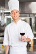 Chef Holding Glass Of Red Wine