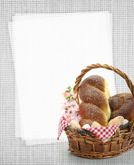 Easter sweet bread in a basket with blank paper recipe card