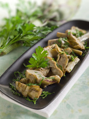 sauteed artichoke on dish selective focus