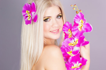 Portrait of very beautiful woman with orchid
