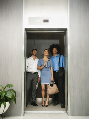 Business people using elevator