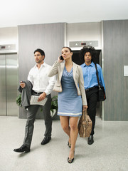 Business people leaving elevator