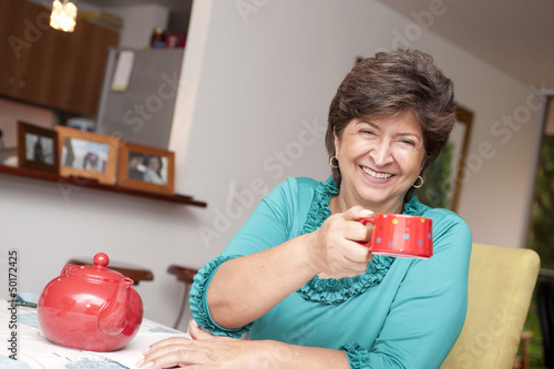 Hispanic woman drinking tea