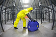 fully protected  technician,rolling a barrel wh toxic substance - 50172643
