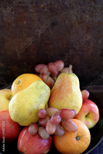 Fresh pears, oranges, apples and grapes