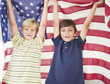 Boys holding American flag together