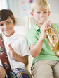 Boys playing musical instruments