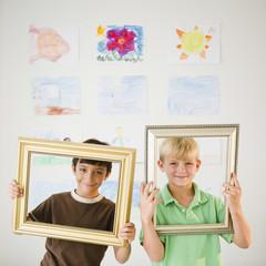Boys looking through empty frames