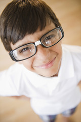 Boy wearing eyeglasses repaired with tape