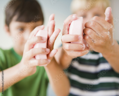 Boys washing their hands with soap
