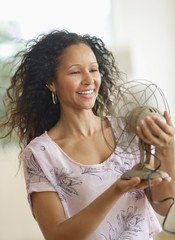 Hispanic woman holding old-fashioned fan