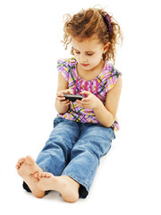 Little girl playing games in her cell phone
