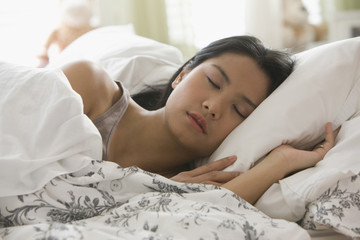 Asian woman sleeping in bed