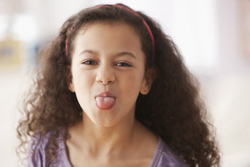 Hispanic girl sticking out tongue