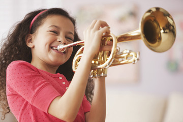 Hispanic girl playing trumpet