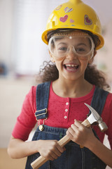Hispanic girl dressed in construction costume