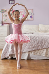 Hispanic girl in ballerina costume