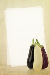 Recipe card. Eggplants on fabric texture