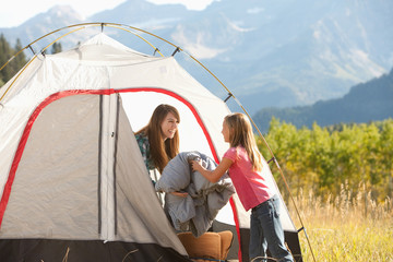 Caucasian mother and daughter camping