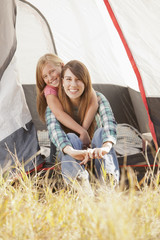 Caucasian mother and daughter camping together