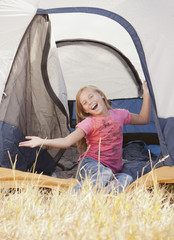 Caucasian girl sitting in tent