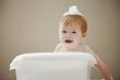 Caucasian baby girl having a bath