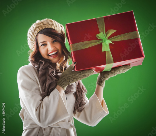 Mixed race woman holding Christmas gift