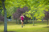 Caucasian woman running in park