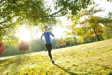Caucasian woman running in park