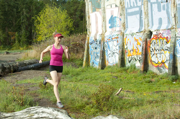 Caucasian woman running near abandoned building