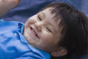 Smiling Hispanic baby boy