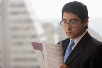 Chilean businessman reading report