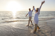 Happy Senior Couple Holding Hands Sunset Sunrise Beach
