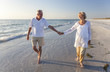 canvas print picture - Happy Senior Couple Walking Holding Hands Tropical Beach
