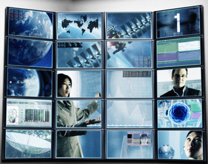 Multiple digital television screens showing futuristic images