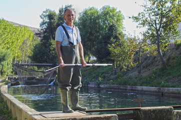 Hispanic fisherman holding net