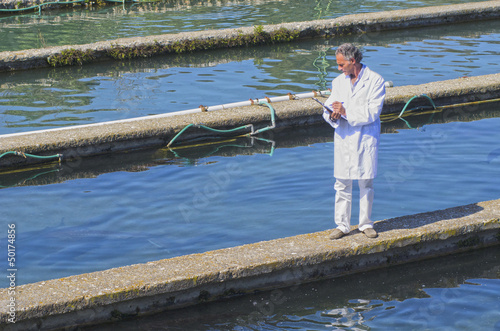 Hispanic man working in fish hatchery