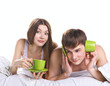 young couple in bed with communication problems
