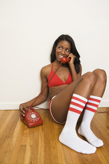 Woman in underwear talking on telephone