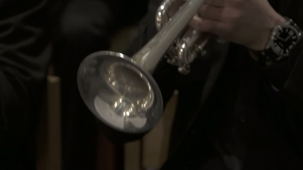 Playing trumpet close up