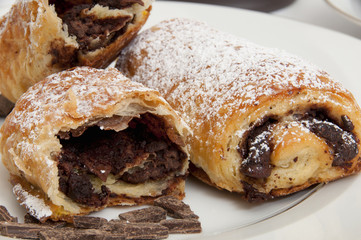 Powdered sugar on chocolate croissants