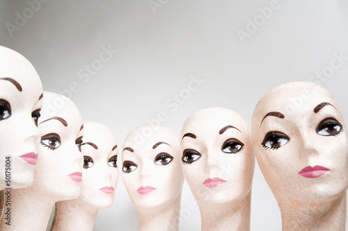 Group of bald, female mannequin heads
