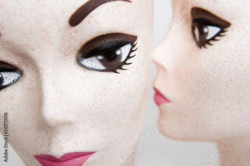 Two female mannequin heads