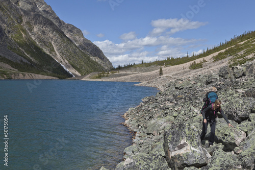Caucasian woman hiking near lake