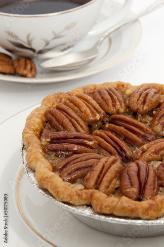 Small pecan pie and cup of coffee