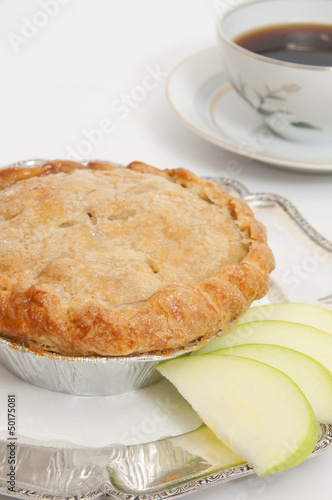Small apple pie and cup of coffee