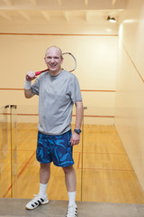 Hispanic man relaxing after racquetball