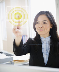 Japanese businesswoman touching digital screen