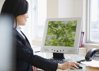 Japanese businesswoman using computer