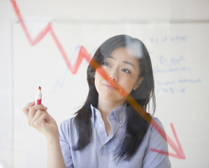 Japanese businesswoman drawing red arrow